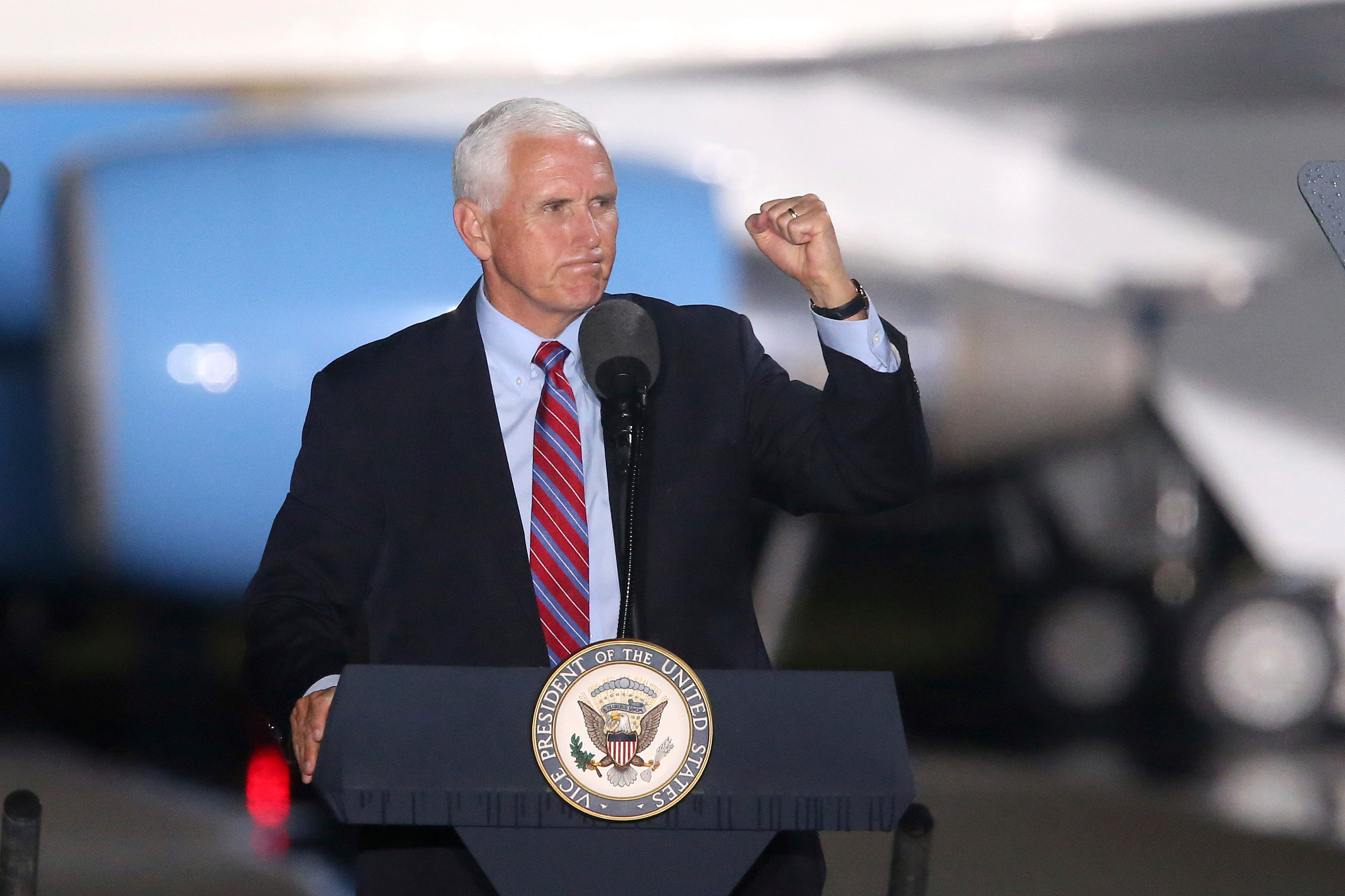 He s not just campaigning, he s working : Pence will still campaign, despite aide s COVID-19 case