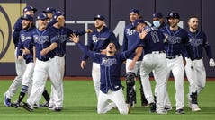 The Rays celebrate their walk-off win against the Dodgers.