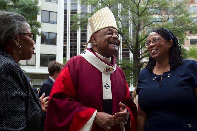 In this Sunday Oct. 6, 2019, file photo, Washington D.C. Archbishop Wilton Gregory greets churchgoers at St. Mathews Cathedral after the annual Red Mass in Washington.