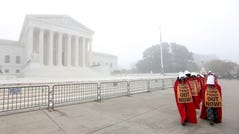 """WASHINGTON, DC - OCTOBER 22: On a foggy morning, protesters with the """"Handmaids Brigade"""" march outside the U.S. Supreme Court prior to a hearing held by the Senate Judiciary Committee to vote on the nomination of Judge Amy Coney Barrett on October 22, 2020 in Washington, DC. The committee is expected to formally confirm the nomination later today, with the full U.S. Senate scheduled to vote on the nomination next Monday. (Photo by Win McNamee/Getty Images) *** BESTPIX *** ORG XMIT: 775580351 ORIG FILE ID: 1281642020"""