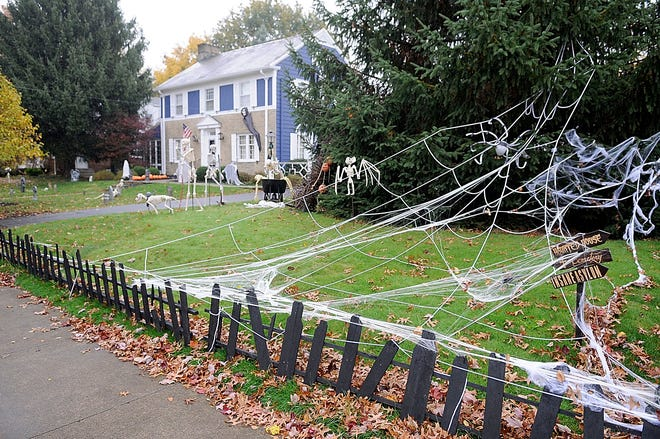 This home at 59 Samaritan Avenue is ready for Thursday night's trick-or-treat night in the city of Ashland with it's yard decorated with cob webs, skeletons and grave markers. TOM E. PUSKAR/TIMES-GAZETTE.COM