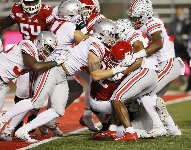 Last season, before making the move from defensive end to tight end for Ohio State, Lexington grad Cade Stover (center) helps stop Rutgers running back Kay'Ron Adams at the goal line. OSU won that game 56-21.