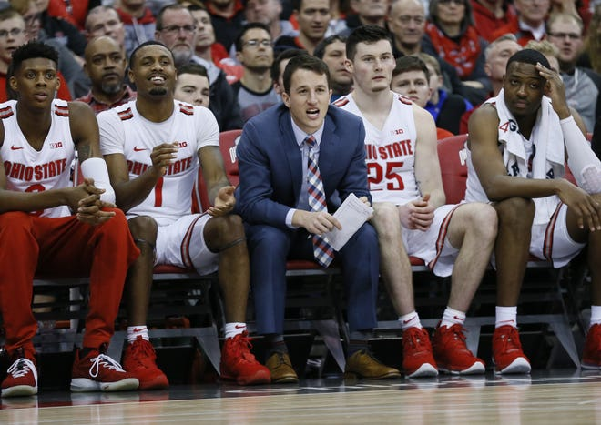Andrew Dakich, middle, yells from the bench during a game against Southeast Missouri State in December.