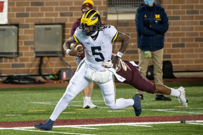 First-time starting quarterback Joe Milton (5) made all the right moves in Michigan's 49-24 victory over Minnesota, helping the Wolverines jump three spots to No. 3  in the Big Ten power rankings.