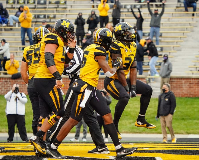 Larry Rountree III (34) celebrates with teammates after scoring a touchdown against the Kentucky Wildcats on Saturday. Rountree's run later in the game would help seal the Tigers' 20-10 win over the Wildcats.