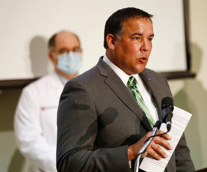 Columbus mayor Andrew Ginther tells people to wear their masks and stay home as he talks about the increase in COVID-19 cases during a news conference at Columbus Public Health on Oct. 26.
