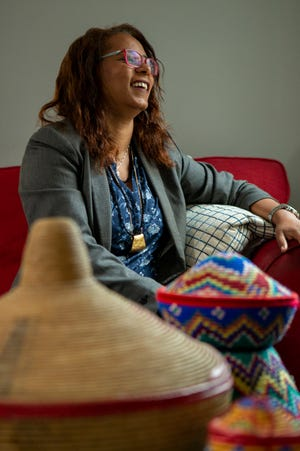 Seated behind a collection of woven pots that her mother made, Michal Avera Samuel sits inside her Bexley living room. The former Ethiopian refugee who made her way to Israel via Sudan is now the JewishColumbus shlicha.