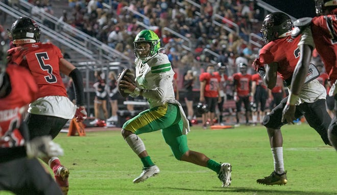 Lake Minneola's Robbie Sanders (1) looks for a receiver during Friday's game against South Sumter at Inman Sherman Field at Raiders Stadium. [PAUL RYAN / CORRESPONDENT]