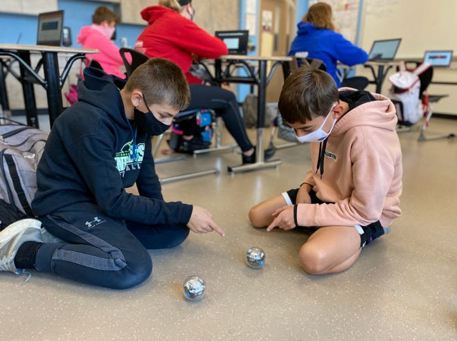 "Peyton Ware (left) and Carter Simms are in Jud Hartman's eighth-grade project-based learning science class at Chippewa JR/SR High School. The teachers says it's a ""best practice for independent thinks and learners."""