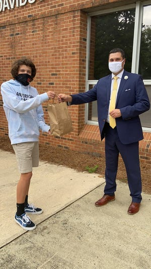 North Davidson High School was one of the schools that received face masks from Teens in Action. Pictured are Owen Miller with NDHS Principal Jonathan Brown.