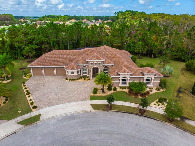 This lavish custom-built estate by Olsen homes, backing up to a preserve, is situated in the most desirable location in Portofino Estates — the gated golf community of Venetian Way.