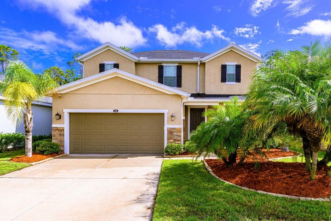 Beautiful landscaping and stone accents are the first impressions of this spacious, well-maintained own-owner home in Daytona Beach.