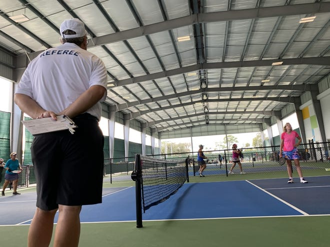 A referee oversees a match on one of the covered courts at the new Pictona pickleball complex in Holly Hill on Oct. 23, 2020, opening day of the three-day Pictona Fall Vintage Pickleball Tournament. Pictona founders Rainer and Julie Martens are asking the City of Holly Hill for $200,000 in incentives to help with some of the costs of a nearly $2 million Phase II expansion of Pictona that would allow it to host tournaments on a more frequent basis.