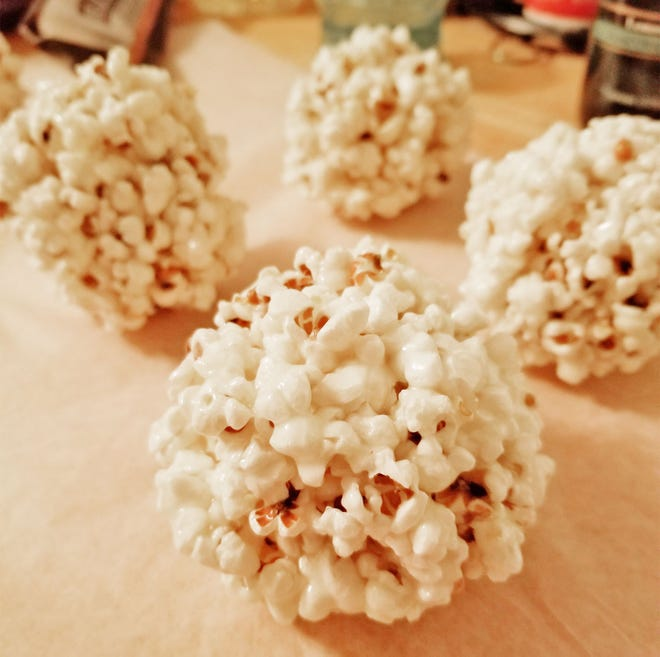 Fresh popcorn balls are a delicious fall treat that's easy to make.