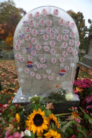 "A plastic cover protects the headstone of Susan B. Anthony from ""I Voted Today"" stickers  in Mt. Hope Cemetery in Rochester, N.Y. The Friends of Mt. Hope placed the plastic cover on the headstone."