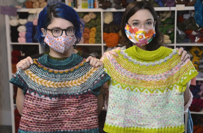 Twins Jes Velez, left, and Erica Velez, both 30 and of Millcreek Township, display sweaters they've knitted. They were visiting Habetrot's Wheel, the knitting-supply shop they frequent in Harborcreek Township. The women enjoy knitting a variety of items.