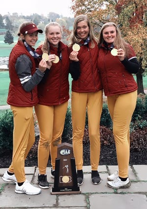 Members of the North East girls golf team show off the PIAA Class 2A medals and trophy after the Grapepickers won the team state title Monday at Heritage Hills Golf Resort in York. From left are Anna Swan, Ellise Sebolt, Lydia Swan and Taylor Urban.