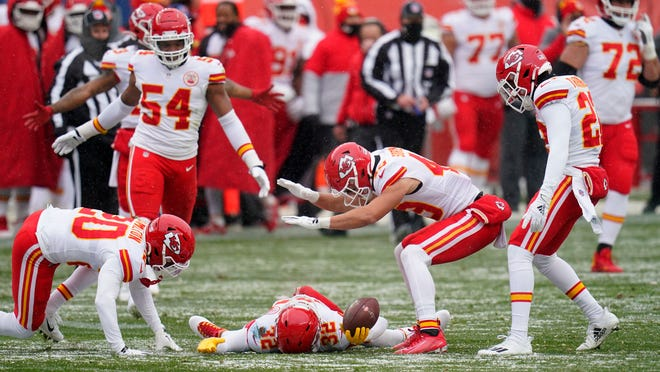 Kansas City Chiefs strong safety Tyrann Mathieu, below, makes a snow angel on the field after picking up a fumble during the first half of Sunday's game in Denver. The Chiefs forced four turnovers in a 43-16 win.