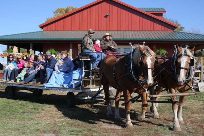 In this file photo, people enjoy a hayrack ride Oct. 7, 2012, at Harvestville Farm near Donnellson.