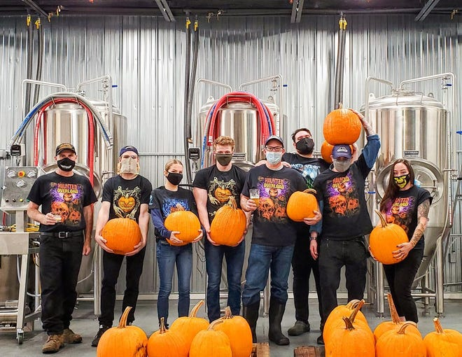 """Stripe Nine Brewing in Somersworth has partnered with Demeritt Hill Farm in Lee to produce a pumpkin-flavored beer named """"Haunted Overload,"""" after the popular Halloween attraction on the farm."""