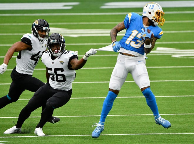 Jaguars linebacker Quincy Williams gets a piece of Keenan Allen's jersey during Sunday's game in Los Angeles.