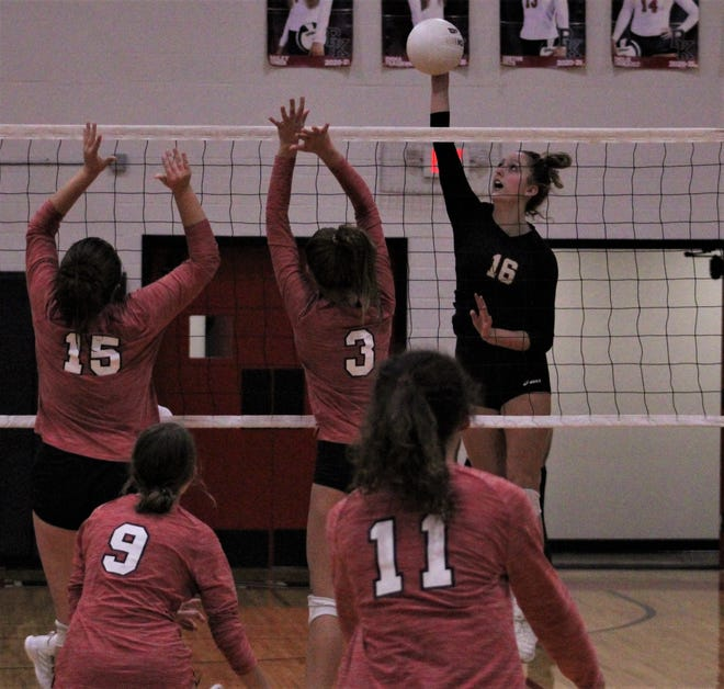 Bishop Kenny sophomore Allison Cavanaugh (16) leaps high to score against Baker County in Thursday's regional quarterfinal in volleyball.