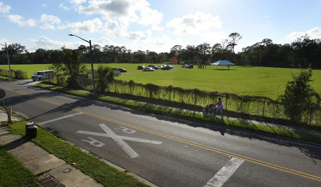 The old Fairfax Street Wood Treaters site was clear and cleaned when officials from Jacksonville and the U.S. Environmental Protection Agency celebrated completion of the $10 million cleanup of the former Superfund pollution site.