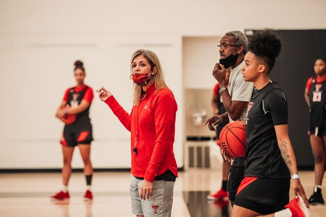 Texas Tech women's basketball coach Krista Gerlich (center) knows the regular season will begin with a 7 p.m. Nov. 25 home game against UTRGV at United Supermarkets Arena.