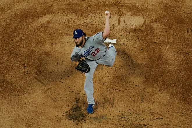 Los Angeles Dodgers starting pitcher Clayton Kershaw throws against the Tampa Bay Rays during the first inning in Game 5 of the World Series on Sunday in Arlington, Texas.