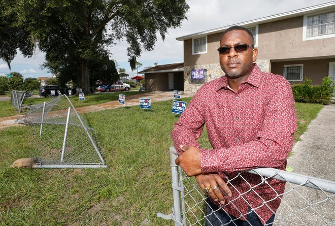 Cornelius Marion stands in front of his neighbor's home where James Blight tore down a chain-link fence with a stolen front-end loader and removed Joe Biden campaign signs on Saturday in Haines City. Marion followed the man and called 911 to alert the Haines City Police Department. Police allege that Blight, a resident of Haines City, stole a backhoe from a job site and drove through the Oakland community tearing down Biden signs.