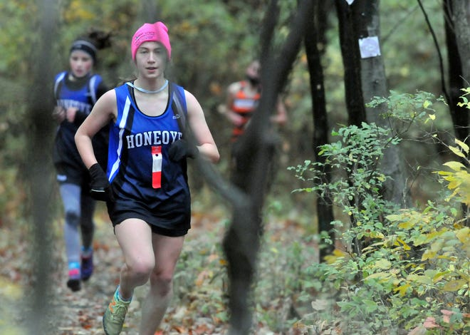 Honeoye's Audrey Gillette leads teammate Zara Olsen through the woods at Saturday's meet at Ontario County Park.
