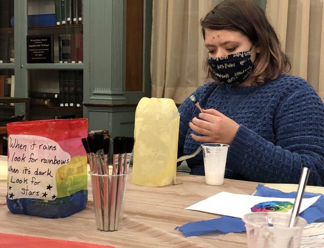 JMG eighth-grader Liam Bolduc makes a lantern at Goodall Library on Thursday, Oct. 22. His lantern and hundreds of others will be hung along Number One Pond in Sanford for Halloween this weekend.