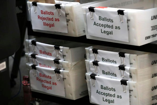 Boxes of illegal and legal vote-by-mail ballots at the Miami-Dade County Elections Department ahead of Florida's Aug. 18 primary election.