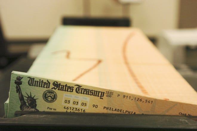 FILE - In this Feb. 11, 2005 file photo, trays of printed social security checks wait to be mailed from the U.S. Treasury's Financial Management services facility in Philadelphia. [AP Photo/Bradley C. Bower]