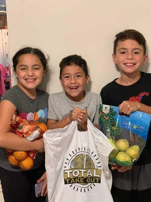 Farm to Family, a program of the Boys & Girls Clubs of Palm Beach County, distributes groceries to Club members and their families.