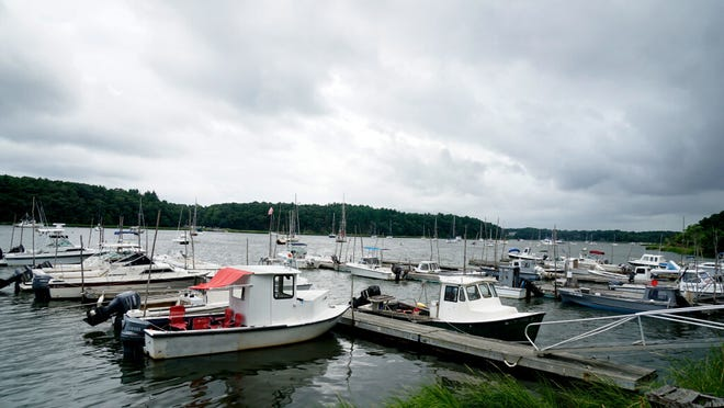 Lobster boats are tied up in East Greenwich on a Sunday afternoon in August. [The Providence Journal / Kris Craig]