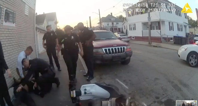 A frame from Providence police body-camera footage of the moped crash that left 24-year-old Jhamal Gonsalves in a coma.