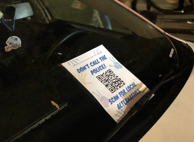 Protesters on Friday distributed fliers with a QR code to scan for alternatives to police.