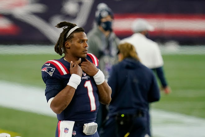 New England Patriots quarterback Cam Newton watches from the sideline after being replaced by Jarrett Stidham in the second half of an NFL football game against the San Francisco 49ers, Sunday, Oct. 25, 2020, in Foxborough, Mass. (AP Photo/Charles Krupa) ORG XMIT: FBO134