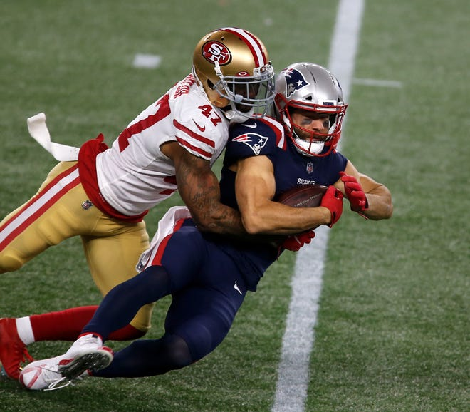 Foxboro, MA, Oct25, 2020 - New England's Julian Edelman is taking down by 49er cornerback Jamar Taylor after a shot  pass in the second half.   The New England Patriots vs. the San Francisco 49ers at Gillette Stadium.    [The Providence Journal / Kris Craig]