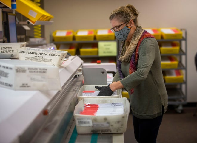 Lane County Elections worker Elaine Erwin prepares ballot envelopes before they are scanned for signatures on Oct. 26.