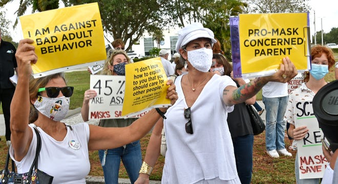 Pro-mask parents protest outside of the Sarasota County School Board meeting on Oct. 20. 2020 in Sarasota.