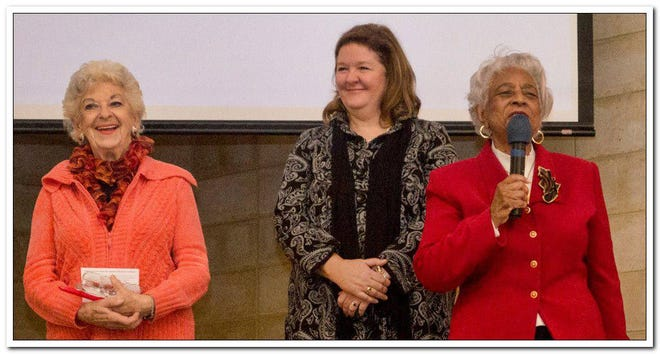Founders of the Women's Interfaith Network, the late Arlene Pearlman (left) and Jacci Tutt (right), receive an award from the Center for Religious Tolerance in 2014.
