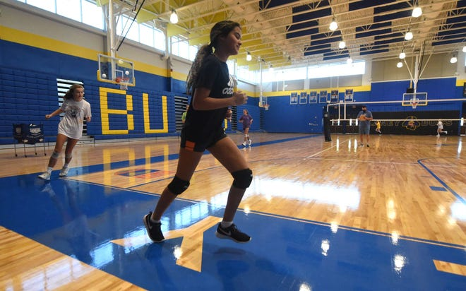 Laney volleyball players practice at the school in Wilmington, N.C., Monday, October 26, 2020. Public schools across the state are preparing to resume sports next week. [MATT BORN/STARNEWS]