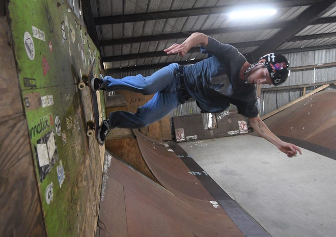 Dan Jones hits the wall while skating at the Skate Barn in Hampstead, N.C., on Monday, Oct. 26, 2020. The business is celebrating its 24th anniversary in November. [MATT BORN/STARNEWS]