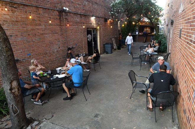 Diners eat at Rebellion NC during Downtown Alive in Wilmington, N.C., Saturday, July 18, 2020.
