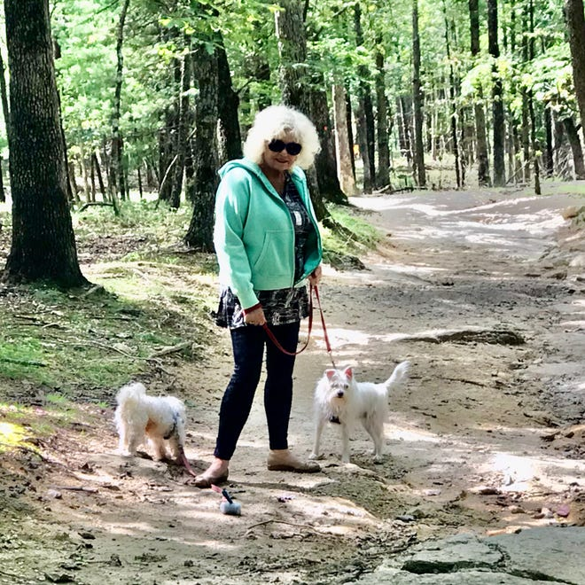 Stephanie Davies of the Fairfield Harbour RV Club contemplates one of the many trails to hike at Stone Mountain. [CONTRIBUTED PHOTO]