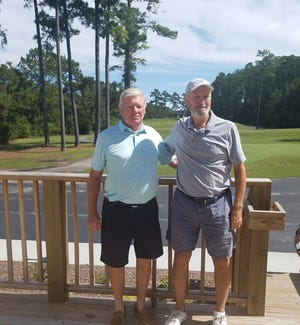 The team of Bruce Hice (left) and Wayne Bedenbaugh won the Gold Flight at the MGA Shark Shootout Tournament. [CONTRIBUTED PHOTO]