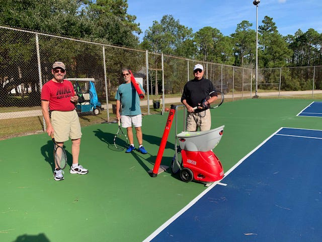 Several tennis members practiced with the Lobster at Red Sail on a beautiful fall day. On the left is new member Charlie Emery, with Howard Neviser, and Lobster owner Jim Hampson. [CONTRIBUTED PHOTO]