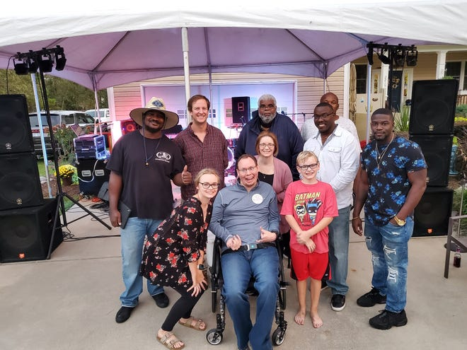 Eric Edmundson and his wife Stephanie, daughter Gracie, and son Hunter enjoyed the company of the Joe Brown Band at Eric's Alive Day celebration. [CONTRIBUTED PHOTO]